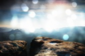 Film effect. Amazing  daybreak in Saxony Switzerland park. Sandstone peaks increased from foggy background