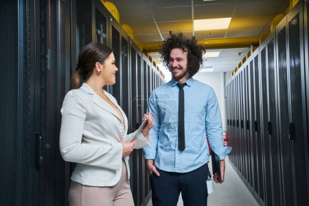 Photo for Young technicians working on servers - Royalty Free Image