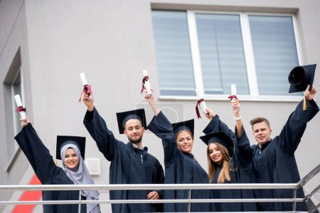 Young people graduating, celebration