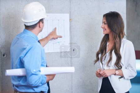 Photo for Business people group on meeting with construction engineer architect looking building blueprint in modern office - Royalty Free Image