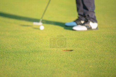 Man Playing Golf in summer