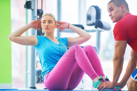 Photo for Woman training with fitness instructor at the gym - Royalty Free Image