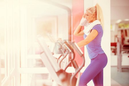 Photo for Woman  exercising on treadmill in the gym - Royalty Free Image