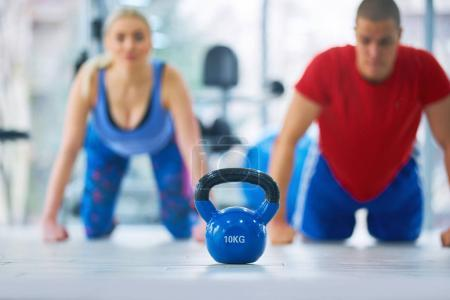 Photo for Group having functional fitness training with kettlebell in sport gym - Royalty Free Image
