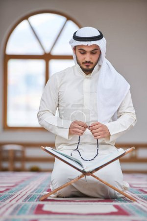 Photo for Religious muslim man praying inside the mosque - Royalty Free Image
