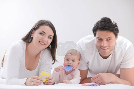 Photo for An image of a happy family of three - Royalty Free Image