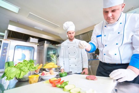 Photo for Chef preparing food in restaurant kitchen - Royalty Free Image
