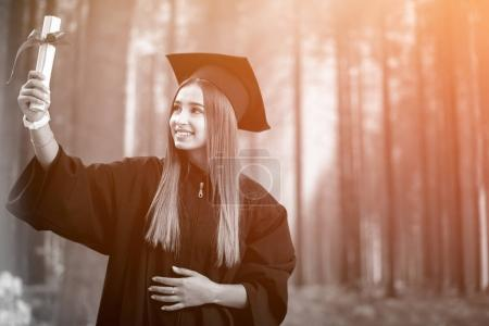 Graduation: Student Standing With Diploma