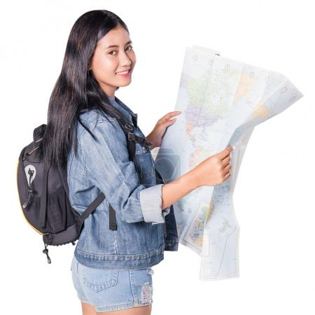Photo for Happy  asian woman travel isolated on white background, asian woman with backpack holding map. Adventure concept - Royalty Free Image