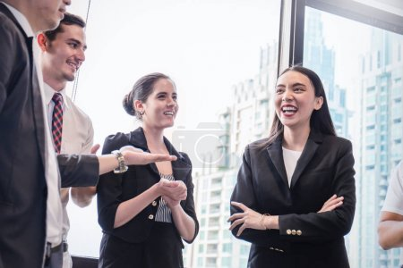 Group of employees talking in business meeting