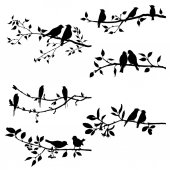 Vector set of birds at trees silhouettes hand drawn songbirds at branches isolated vector elements
