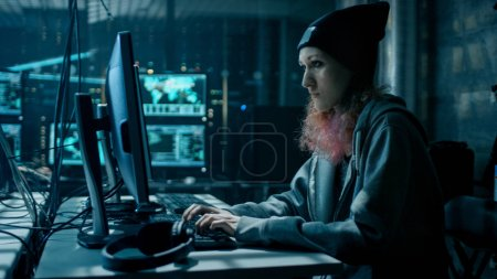 Nonconformist Teenage Hacker Girl Using Computer for Attacking C
