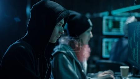 Close-up Shot of Internationally Wanted Boy and Girl Hackers Tea