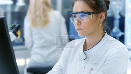 Medical Research Scientist Using Personal Computer. She Works in