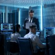 Professional IT Engineers Working in System Contro...