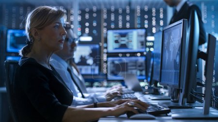 Female Government Employee Works in a Monitoring Room. In The Ba