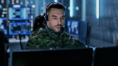 Close-up shot of Military Technical Support Professional Gives I