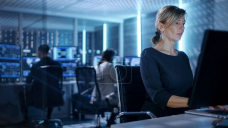 Female IT Engineer Works on Her Desktop Computer in Government S