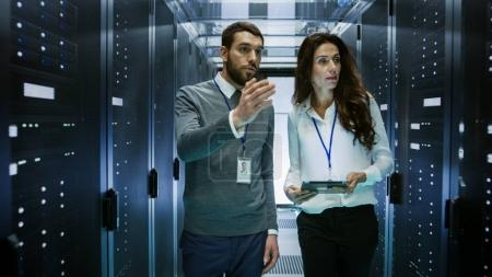 IT Engineer Shows Working Data Center / Server Room to Female Ch