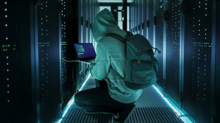 Hacker With Laptop Connects to Rack Server and  Steals Informati