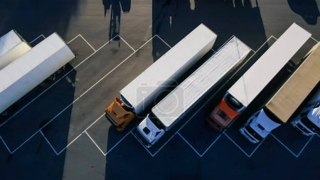 Aerial Top View of White Semi Truck with Cargo Trailer Parking w