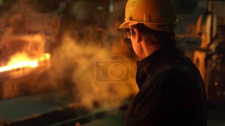 Portrait of Heavy Industry Technician in Hard Hat in Foundry. In