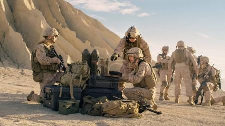 Soldiers are Using Laptop Computer for Surveillance During Milit