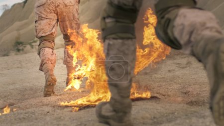 Close-up Shot of Soldiers Legs Running on Burning Ground in the