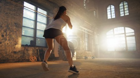 Fit Athletic Woman Does Footwork Running Drill in a Deserted Fac