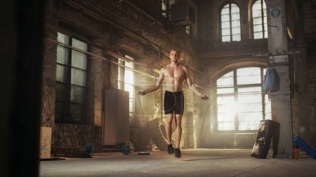 Athletic Shirtless Fit Man Exercises with Jump / Skipping Rope i