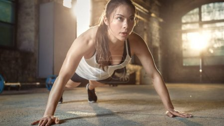 Athletic Beautiful Woman Does Push-ups as Part of Her Cross Fitn