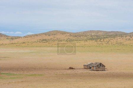 wooden houses among plain
