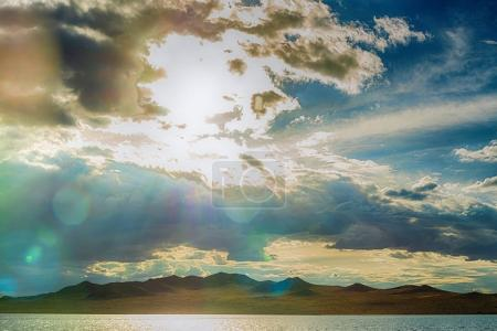 clouds illuminated by sun in sky over sea
