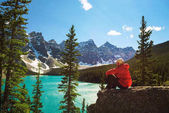 Hiker enjoying the view of Moraine lake in Banff National Park