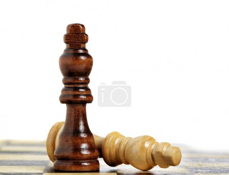 Checkmate wooden pieces on board