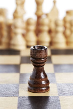 Wooden rook brown chess piece black on chessboard