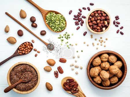 Bowls and spoons of various legumes and different kinds of nuts