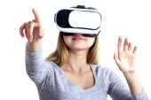 Portrait of a woman in virtual reality glasses poking