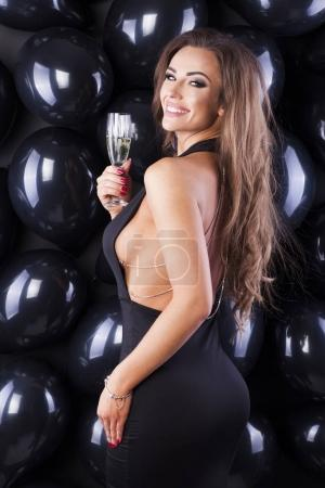 Photo for Sexy woman in black dress with balloons. - Royalty Free Image