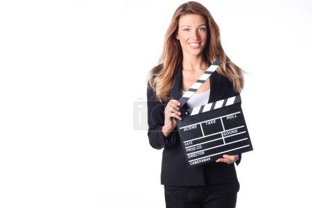 Photo pour Belle femme blonde tenant un clapperboard . - image libre de droit