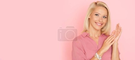 Photo for Elegant, adult blonde with charming smile. - Royalty Free Image
