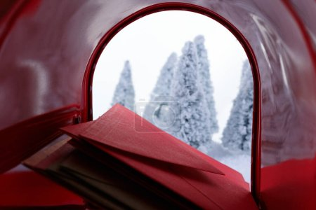 Mail box filled with letters to santa claus...