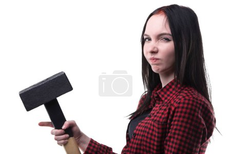 Frowned young brunette with big hammer