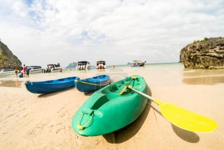 Photo for Sandy beach with kayaks amd speedboats in Ang Thong near Ko Samui - Beautiful tropical destination in Thailand - Travel concept to nature wonders around the world - Warm sunny afternoon color tones - Royalty Free Image