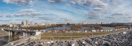 Moscow. A view from above on  Moscow Ring Road, traffic jam, Moscow River, South Tushino, Strogino and car parking near the Crocus Expo Exhibition Center