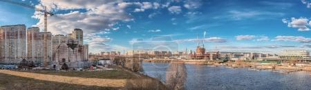 Moscow region. Panorama. Church of St. Nicholas the Wonderworker in the Pavshinsky floodplain, the Moscow River, new buildings and a yacht club in the Crocus City.