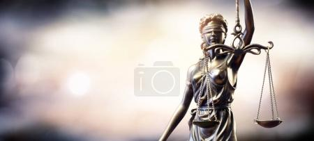 Statue Of Lady Justice On Blurred Background...