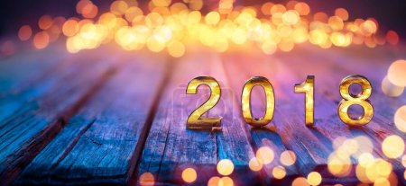 2018 - Happy New Year - Golden Numbers On Defocused Table And Bokeh Lights