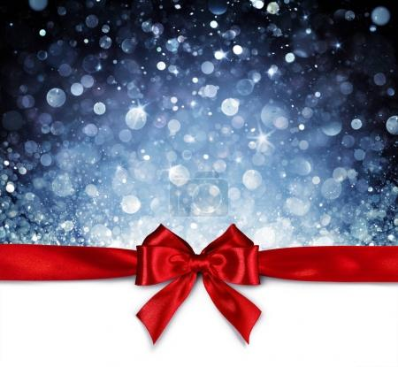 Photo for Red Ribbon With Shiny Blue Background - Christmas Card - Royalty Free Image