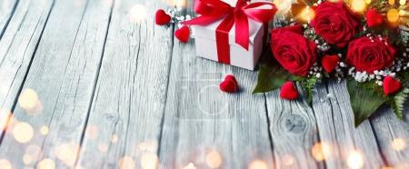 Valentines Card - Gift Box And Roses On Wooden Table With Lights